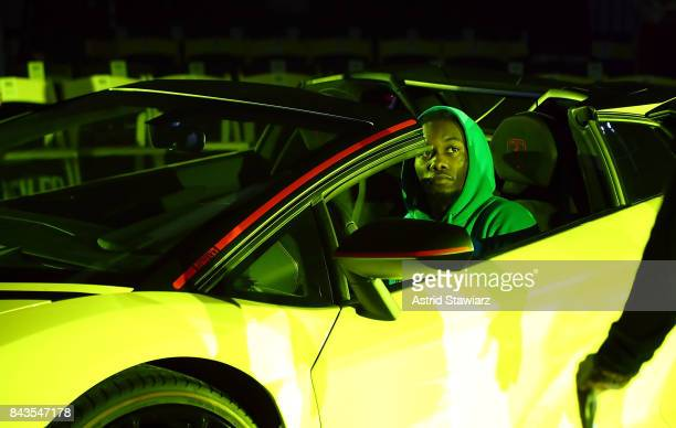 Rapper Offset from the rap group Migos drives a yellow Lamborghini during rehearsal for the VFILES show during New York Fashion Week at Barclays...
