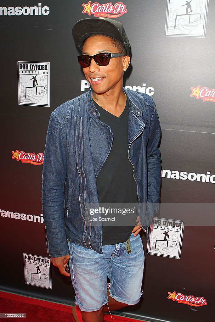 Rapper Pharell arrives to the Rob Dyrdek Foundation's 'Sk8 For Life' Benefit at Fantasy Factory on May 22, 2010 in Los Angeles, California.