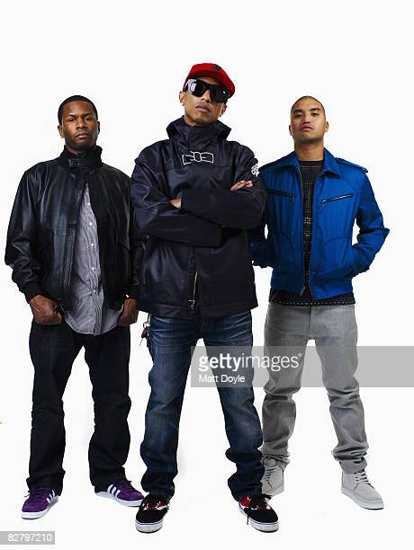 Rapper Pharrell poses with Chad Hugo and Shay Haley at a portrait session in New York City