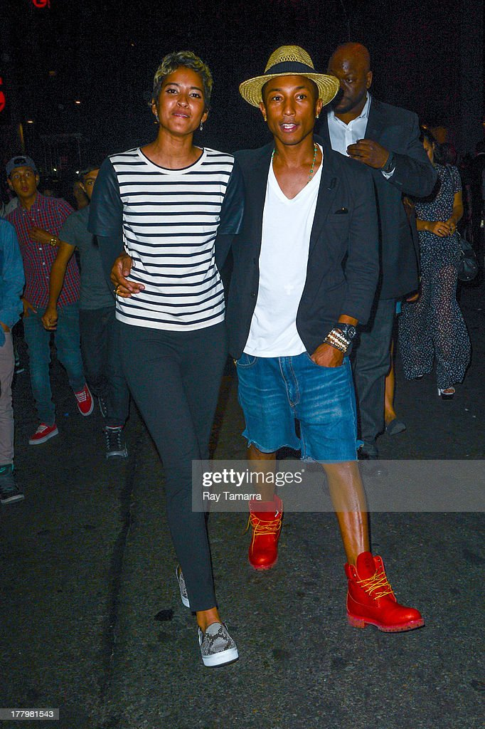 Rapper <a gi-track='captionPersonalityLinkClicked' href=/galleries/search?phrase=Pharrell+Williams&family=editorial&specificpeople=161396 ng-click='$event.stopPropagation()'>Pharrell Williams</a> (R) and Helen Lasichanh leave the Dream Downtown hotel on August 25, 2013 in New York City.