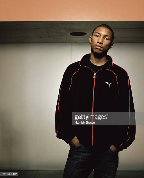 Rapper Pharrell Williams poses for a portrait shoot for NME magazine in London March 18 2003