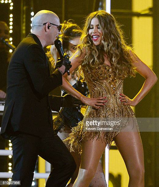 Rapper Pitbull and actress Sofia Vergara perform onstage during The 58th GRAMMY Awards at Staples Center on February 15 2016 in Los Angeles California