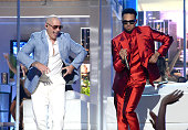 Rapper Pitbull and singer Chris Brown perform onstage during the 2015 Billboard Music Awards at MGM Grand Garden Arena on May 17 2015 in Las Vegas...