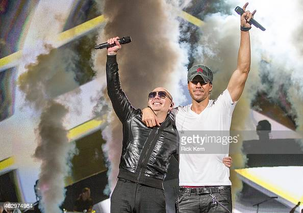 Rapper Pitbull and singersongwriter Enrique Iglesias perform in concert at The Frank Erwin Center on February 7 2015 in Austin Texas