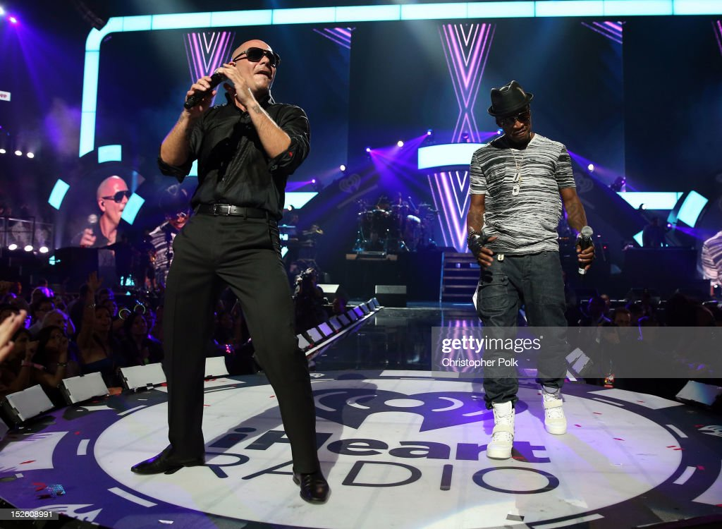 Rapper Pitbull (L) and singer/songwriter Ne-Yo perform onstage during the 2012 iHeartRadio Music Festival at the MGM Grand Garden Arena on September 22, 2012 in Las Vegas, Nevada.