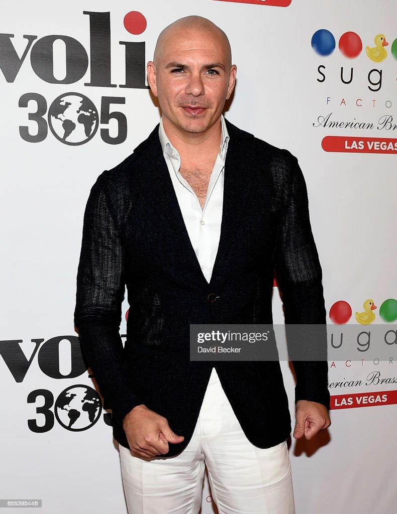 Rapper Pitbull arrives at Sugar Factory American Brasserie at the Fashion Show mall to announce the launch of his Voli 305 vodka brand's exclusive partnership with the restaurant on March 19, 2017 in Las Vegas, Nevada.