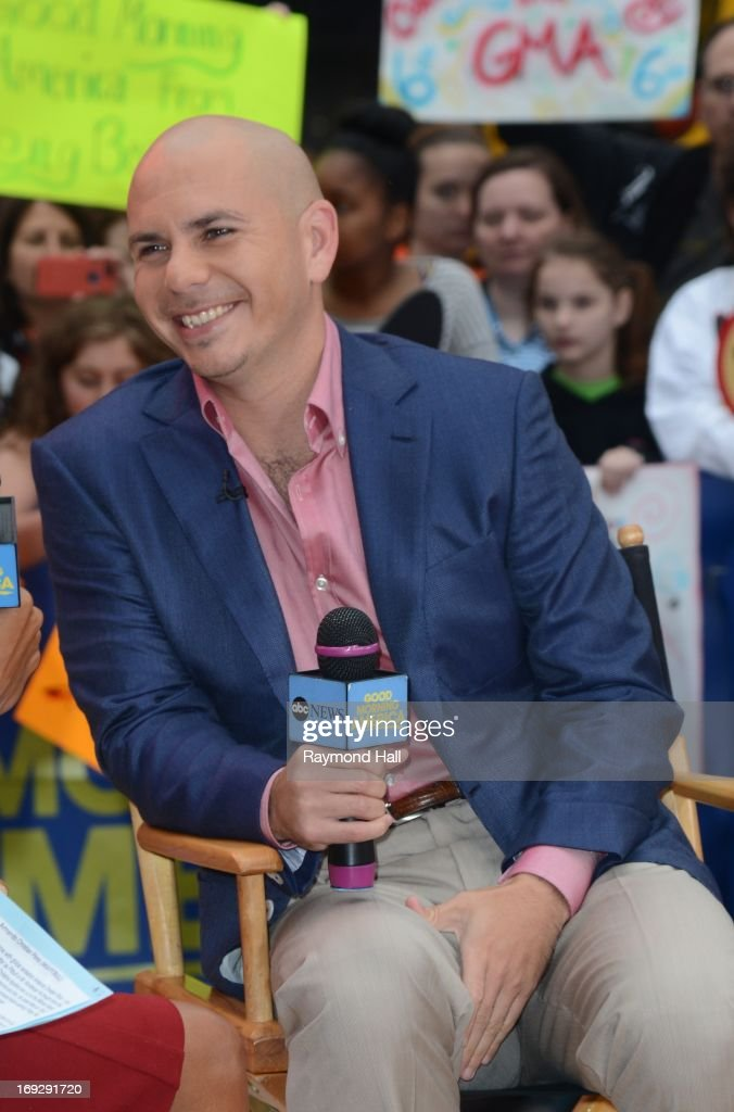 Rapper Pitbull enters the 'Good Morning America' taping at the ABC Times Square Studios on May 22, 2013 in New York City.