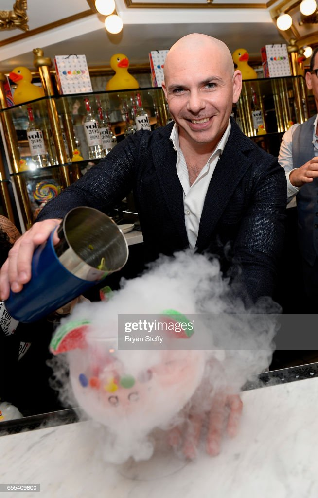 Rapper Pitbull makes a 'Watermelon Mojito' at Sugar Factory American Brasserie at the Fashion Show mall as he announces the launch of his Voli 305 vodka brand's exclusive partnership with the restaurant on March 19, 2017 in Las Vegas, Nevada.