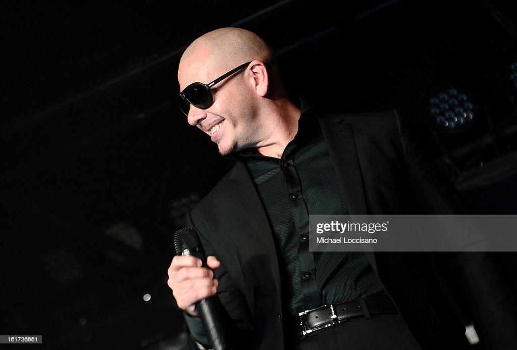 Rapper Pitbull performs at Club SI Swimsuit at 1 OAK Nightclub at The Mirage Hotel & Casino on February 14, 2013 in Las Vegas, Nevada.