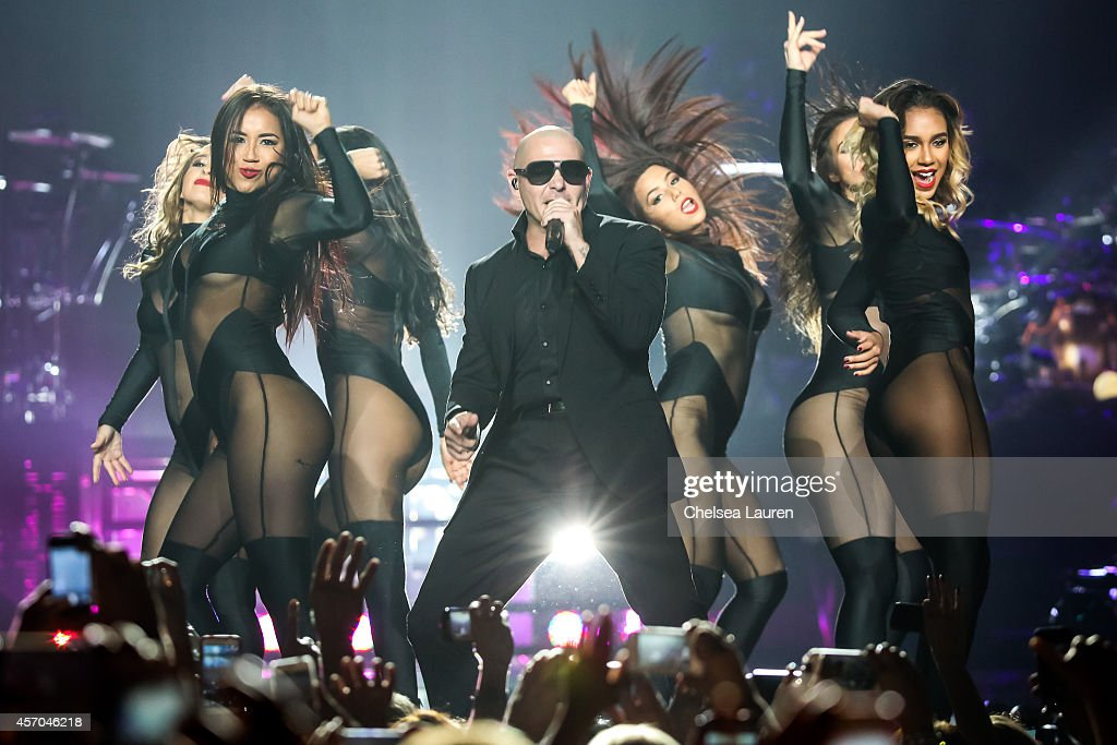 Rapper <a gi-track='captionPersonalityLinkClicked' href=/galleries/search?phrase=Pitbull+-+Rapper&family=editorial&specificpeople=206389 ng-click='$event.stopPropagation()'>Pitbull</a> performs at Staples Center on October 10, 2014 in Los Angeles, California.
