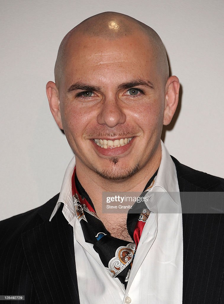Rapper <a gi-track='captionPersonalityLinkClicked' href=/galleries/search?phrase=Pitbull+-+Rapper&family=editorial&specificpeople=206389 ng-click='$event.stopPropagation()'>Pitbull</a> poses in the press room during the 2010 American Music Awards held at Nokia Theatre L.A. Live on November 21, 2010 in Los Angeles, California.