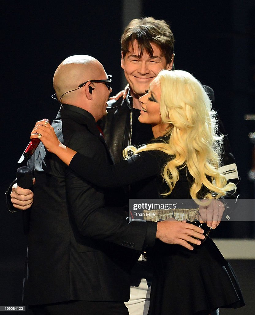 Rapper Pitbull, singer <a gi-track='captionPersonalityLinkClicked' href=/galleries/search?phrase=Morten+Harket&family=editorial&specificpeople=675547 ng-click='$event.stopPropagation()'>Morten Harket</a> of A-ha and singer <a gi-track='captionPersonalityLinkClicked' href=/galleries/search?phrase=Christina+Aguilera&family=editorial&specificpeople=171272 ng-click='$event.stopPropagation()'>Christina Aguilera</a> perform onstage during the 2013 Billboard Music Awards at the MGM Grand Garden Arena on May 19, 2013 in Las Vegas, Nevada.