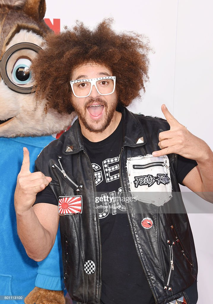Rapper Redfoo of LMFAO arrives at the premiere of 20th Century Fox's 'Alvin And The Chipmunks The Road Chip' at the Zanuck Theater at 20th Century...