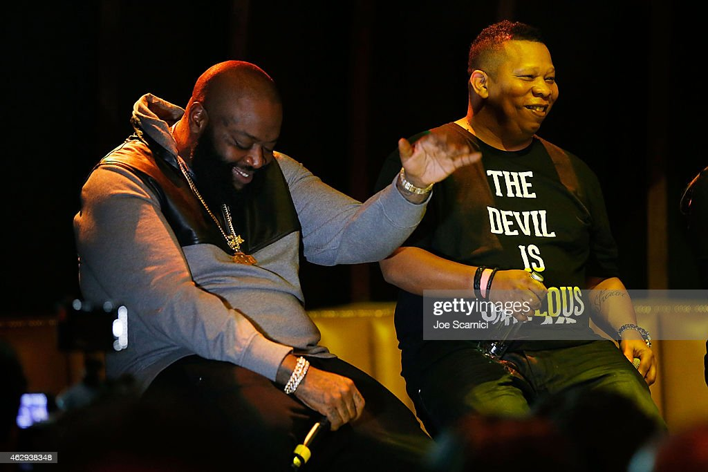 Rapper Rick Ross and DJ Mannie Fresh speak onstage during BMI How I Wrote That Song at 1OAK on February 7 2015 in West Hollywood California