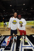 Rapper Romeo Miller and Comedian Kevin Hart pose during the Sprint NBA AllStar Celebrity Game at Sprint Arena as part of 2014 NBA AllStar Jam Session...