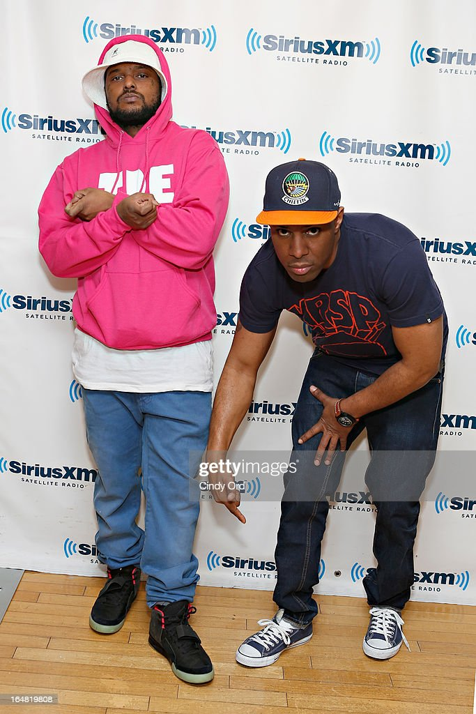 Rapper ScHoolboy Q of Black Hippy poses with SiriusXM DJ Whoo Kid at the SiriusXM Studios on March 28, 2013 in New York City.