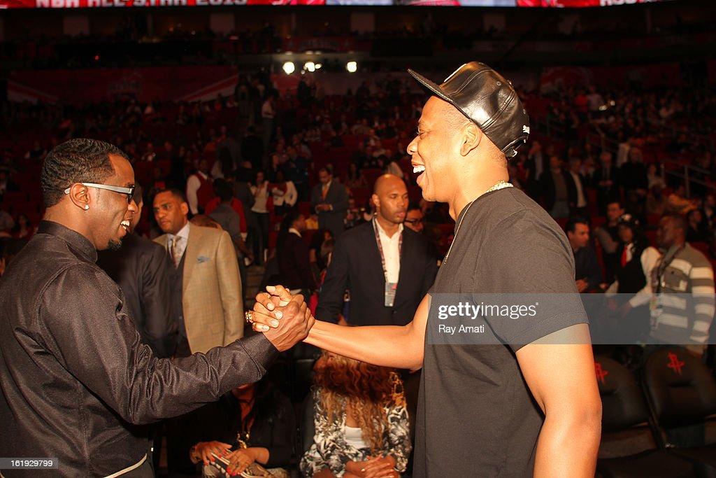 Rapper Sean P. Diddy Combs and Jay Z high five each other during the 2013 NBA All-Star Game during All Star Weekend on February 17, 2013 at the Toyota Center in Houston, Texas.