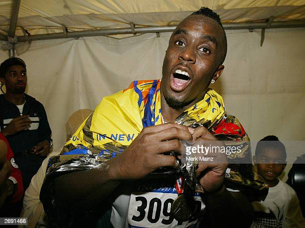Rapper Sean 'P Diddy' Combs celebrates after running the New York City Marathon in four hours and fourteen minutes November 2 2003 in New York City...