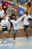 Rapper Sean 'P Diddy' Combs crosses the finish line after running the New York City Marathon in four hours and fourteen minutes November 2 2003 in...