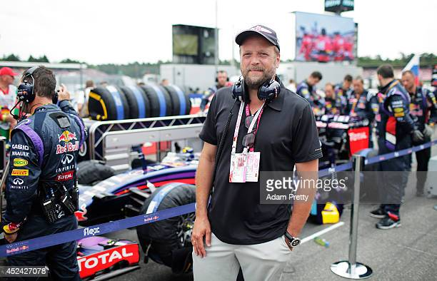 Rapper Smudo poses on the grid next to the Infiniti Red Bull Racing team before the German Grand Prix at Hockenheimring on July 20 2014 in Hockenheim...