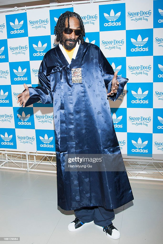 Rapper Snoop Dogg aka Snoop Lion poses for media wearing a South Korean Traditional 'HanBok' costume during a promotional event for 'Adidas' Flagship Store on May 5, 2013 in Seoul, South Korea.