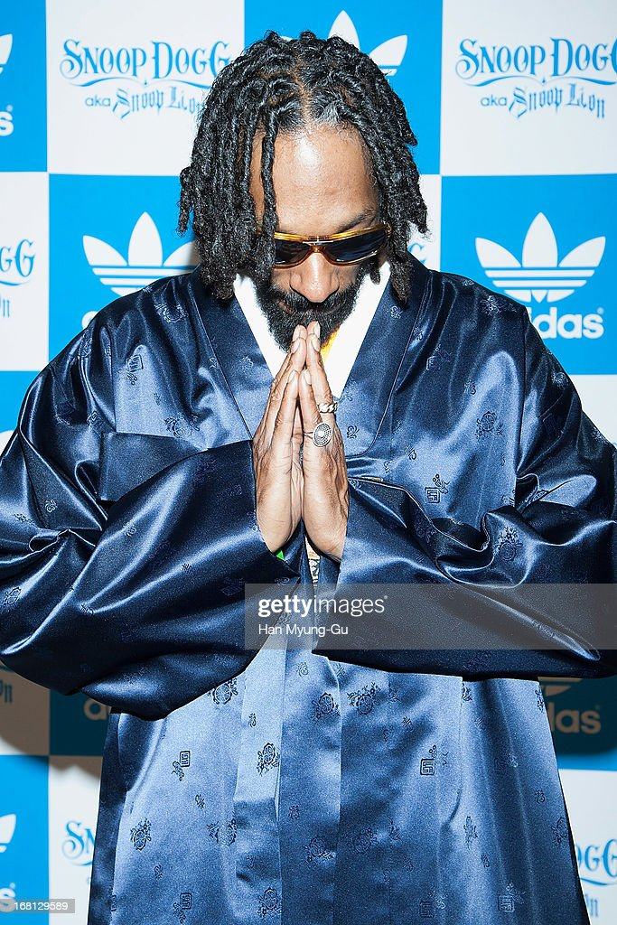 Rapper <a gi-track='captionPersonalityLinkClicked' href=/galleries/search?phrase=Snoop+Dogg&family=editorial&specificpeople=175943 ng-click='$event.stopPropagation()'>Snoop Dogg</a> aka Snoop Lion poses for media wearing a South Korean Traditional 'HanBok' costume during a promotional event for 'Adidas' Flagship Store on May 5, 2013 in Seoul, South Korea.