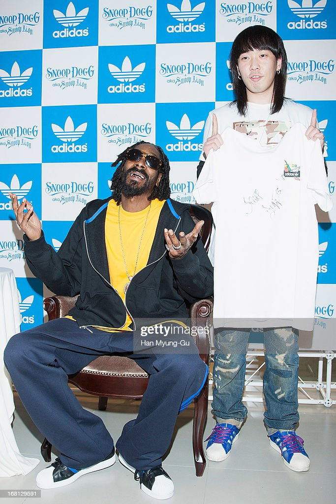 Rapper <a gi-track='captionPersonalityLinkClicked' href=/galleries/search?phrase=Snoop+Dogg&family=editorial&specificpeople=175943 ng-click='$event.stopPropagation()'>Snoop Dogg</a> aka Snoop Lion poses with fans during a promotional event for 'Adidas' Flagship Store on May 5, 2013 in Seoul, South Korea.