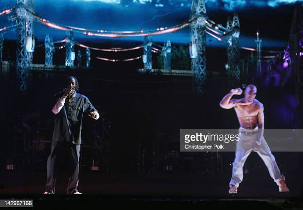 Rapper Snoop Dogg and a hologram of deceased rapper Tupac Shakur perform onstage during day 3 of the 2012 Coachella Valley Music Arts Festival at the...