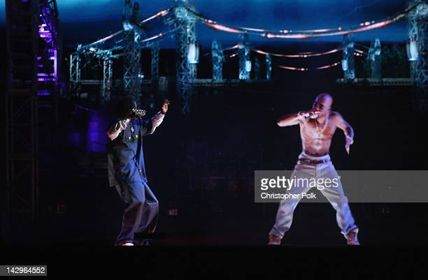 Rapper Snoop Dogg and a hologram of deceased Tupac Shakur perform onstage during day 3 of the 2012 Coachella Valley Music Arts Festival at the Empire...