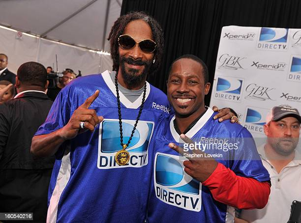 Rapper Snoop Dogg and Desmond Howard attend GBK and DirecTV Celebrity Beach Bowl Thank You Lounge at DTV SuperFan Stadium at Mardi Gras World on...