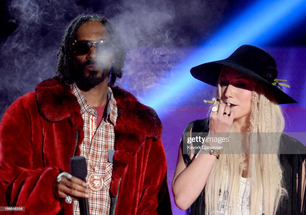 Rapper <a gi-track='captionPersonalityLinkClicked' href=/galleries/search?phrase=Snoop+Dogg&family=editorial&specificpeople=175943 ng-click='$event.stopPropagation()'>Snoop Dogg</a> and singer <a gi-track='captionPersonalityLinkClicked' href=/galleries/search?phrase=Ke%24ha&family=editorial&specificpeople=6718222 ng-click='$event.stopPropagation()'>Ke$ha</a> speak onstage during the 2013 MTV Movie Awards at Sony Pictures Studios on April 14, 2013 in Culver City, California.