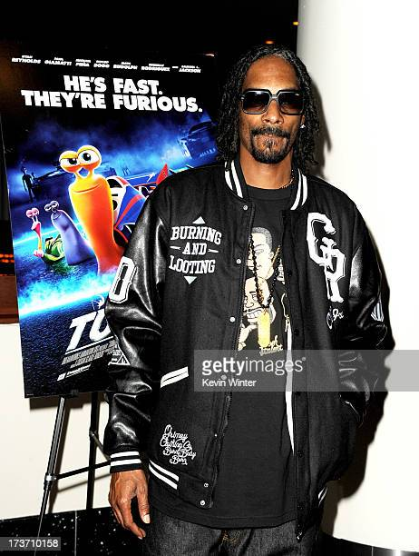 Rapper Snoop Dogg arrives at a special screening of DreamWorks Animation 'TURBO' for the Snoop Youth Football League at the Arclight Theatre on July...