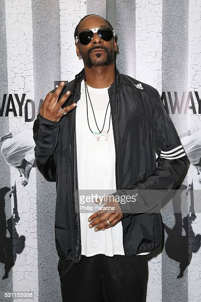Rapper Snoop Dogg arrives at the premiere of Adidas' 'Away Days' at The Orpheum Theatre on May 12 2016 in Los Angeles California