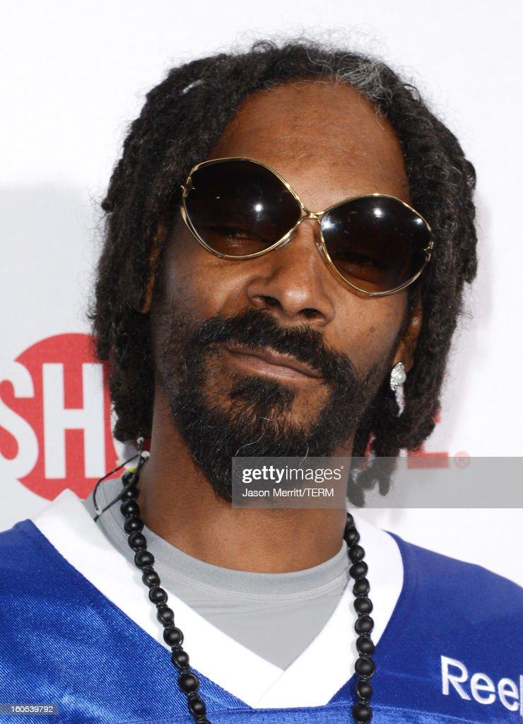 Rapper <a gi-track='captionPersonalityLinkClicked' href=/galleries/search?phrase=Snoop+Dogg&family=editorial&specificpeople=175943 ng-click='$event.stopPropagation()'>Snoop Dogg</a> attends DIRECTV'S Seventh Annual Celebrity Beach Bowl at DTV SuperFan Stadium at Mardi Gras World on February 2, 2013 in New Orleans, Louisiana.