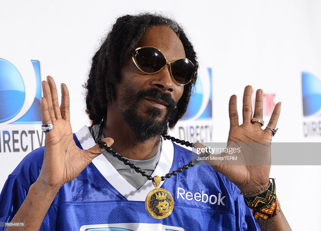 Rapper Snoop Dogg attends DIRECTV'S Seventh Annual Celebrity Beach Bowl at DTV SuperFan Stadium at Mardi Gras World on February 2, 2013 in New Orleans, Louisiana.