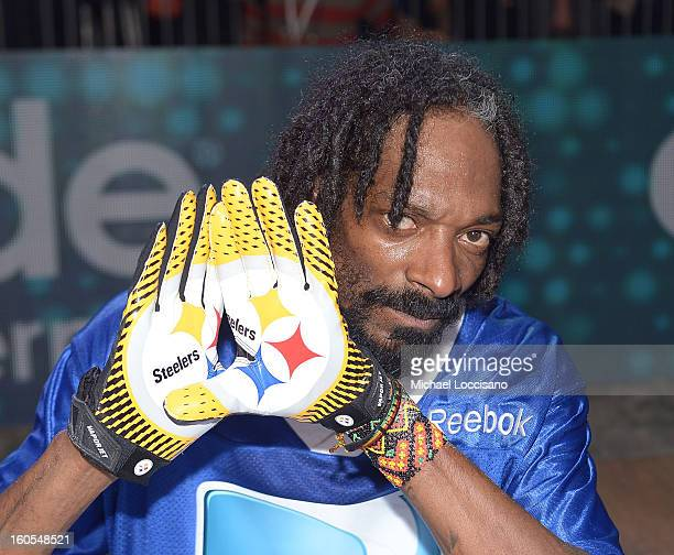 Rapper Snoop Dogg attends DIRECTV'S Seventh Annual Celebrity Beach Bowl at DTV SuperFan Stadium at Mardi Gras World on February 2 2013 in New Orleans...