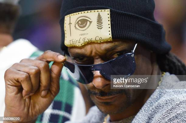 Rapper Snoop Dogg attends Los Angeles Sparks and Minnesota Lynx Game Three of WNBA Finals at Staples Center September 29 in Los Angeles California