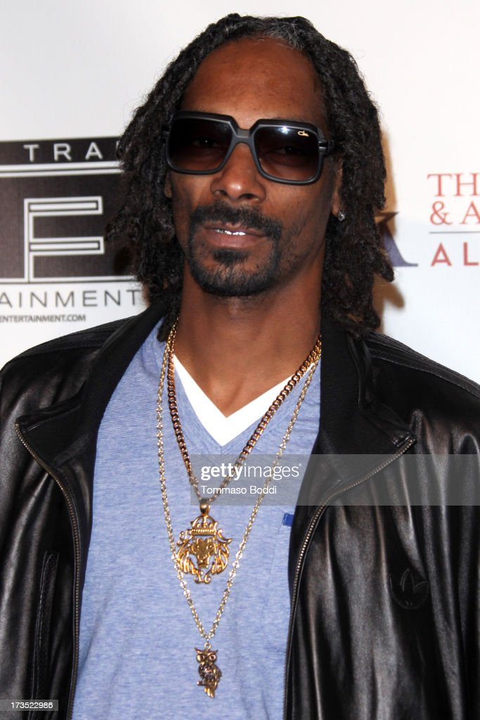 Rapper <a gi-track='captionPersonalityLinkClicked' href=/galleries/search?phrase=Snoop+Dogg&family=editorial&specificpeople=175943 ng-click='$event.stopPropagation()'>Snoop Dogg</a> attends the 8th annual BTE All-Star Celebrity Kickoff Party held at The Playboy Mansion on July 15, 2013 in Beverly Hills, California.