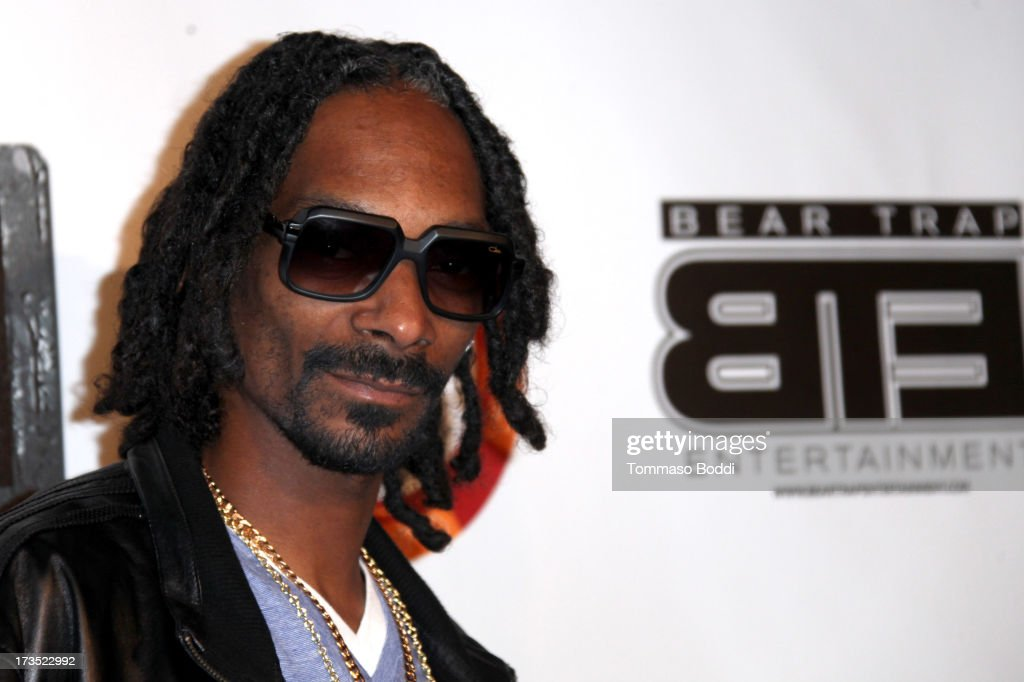 Rapper Snoop Dogg attends the 8th annual BTE All-Star Celebrity Kickoff Party held at The Playboy Mansion on July 15, 2013 in Beverly Hills, California.