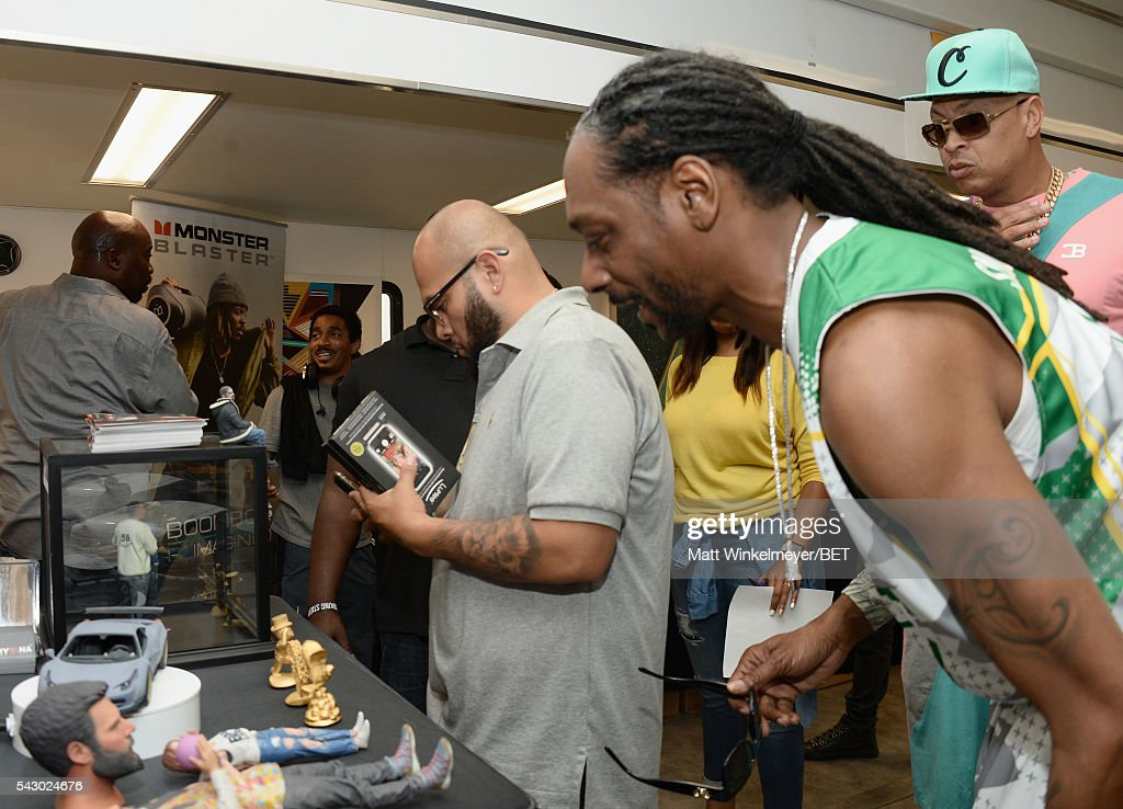 Rapper <a gi-track='captionPersonalityLinkClicked' href=/galleries/search?phrase=Snoop+Dogg&family=editorial&specificpeople=175943 ng-click='$event.stopPropagation()'>Snoop Dogg</a> (R) attends the BETX gifting suite during the 2016 BET Experience on June 25, 2016 in Los Angeles, California.