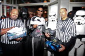 Rapper Snoop Dogg Darth Vader and Stormtroopers launch the Adidas Originals X Star Wars Collection at Foot Locker Times Square on February 4 2010 in...