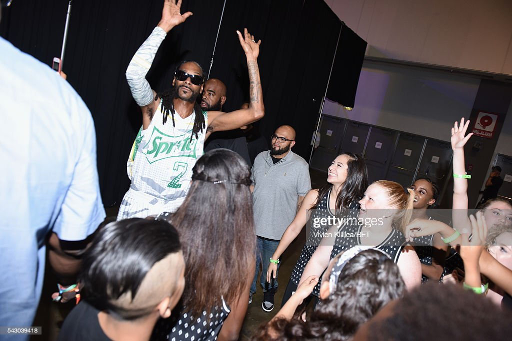 Rapper Snoop Dogg greets fans in the green room at the celebrity basketball game during the 2016 BET Experience at the JW Marriott Los Angeles L.A. Live on June 25, 2016 in Los Angeles, California.