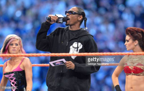 Rapper Snoop Dogg is joined by WWE Divas and Playboy cover girls Ashley and Maria at Wrestlemania XXIV at the Citrus Bowl on March 29 2008 in Orlando...