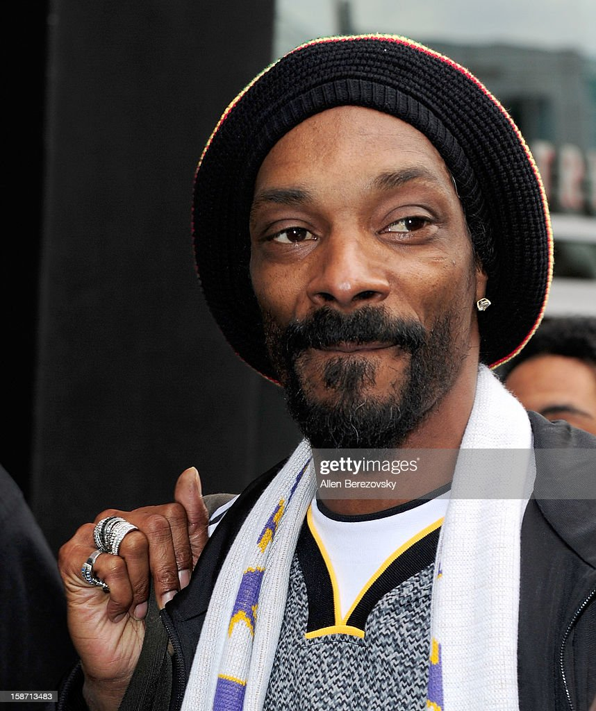 Rapper Snoop Dogg leaves the Staples Center after the Los Angeles Lakers victory over the New York Knicks on December 25, 2012 in Los Angeles, California.