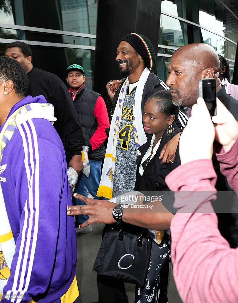 Rapper <a gi-track='captionPersonalityLinkClicked' href=/galleries/search?phrase=Snoop+Dogg&family=editorial&specificpeople=175943 ng-click='$event.stopPropagation()'>Snoop Dogg</a> leaves the Staples Center after the Los Angeles Lakers victory over the New York Knicks on December 25, 2012 in Los Angeles, California.