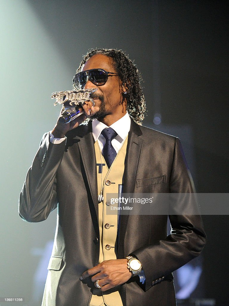 Rapper <a gi-track='captionPersonalityLinkClicked' href=/galleries/search?phrase=Snoop+Dogg&family=editorial&specificpeople=175943 ng-click='$event.stopPropagation()'>Snoop Dogg</a> performs onstage at the Keep Memory Alive foundation's 'Power of Love Gala' celebrating Muhammad Ali's 70th birthday at the MGM Grand Garden Arena February 18, 2012 in Las Vegas, Nevada. The event benefits the Cleveland Clinic Lou Ruvo Center for Brain Health and the Muhammad Ali Center.