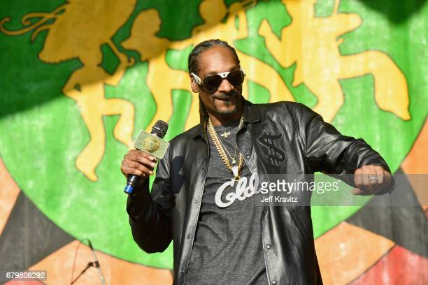 Rapper Snoop Dogg performs onstage during the 2017 New Orleans Jazz Heritage Festival Day 6 at Fair Grounds Race Course on May 6 2017 in New Orleans...