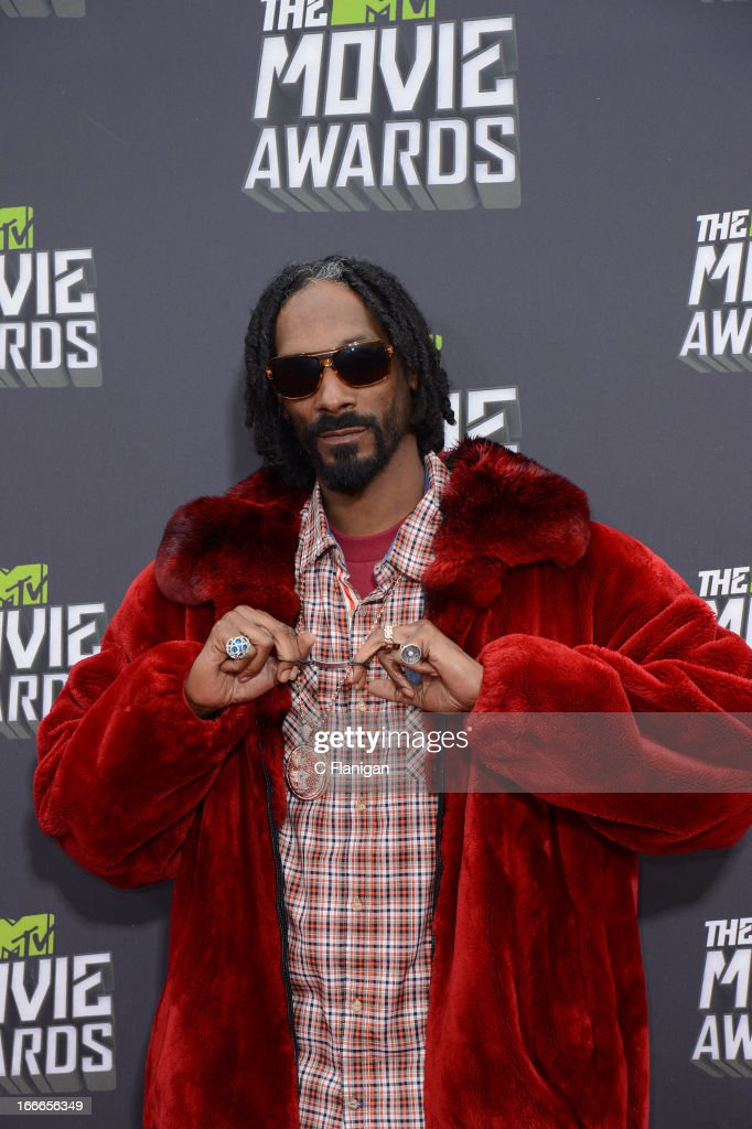 Rapper Snoop Lion aka. Snoop Dogg arrives at the 2013 MTV Movie Awards at Sony Pictures Studios on April 14, 2013 in Culver City, California.
