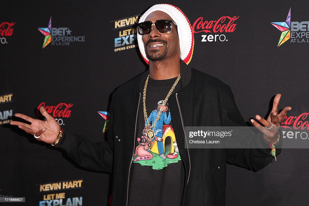 Rapper Snoop Lion arrives at the 'Kevin Hart: Let Me Explain' premiere at Regal Cinemas L.A. Live on June 27, 2013 in Los Angeles, California.