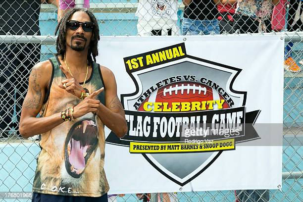 Rapper Snop Dogg attends the 1st Annual Athletes Center Celebrity Flag Football on August 18 2013 in Pacific Palisades California